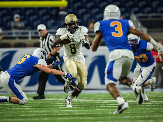 Kolin Demens runs the ball in the 2016 Division 4 state title game at Ford Field.