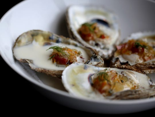 Champagne cream-poached oysters with bacon onion jam