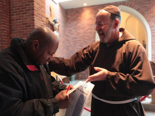 Dennis Pearson, 58 of Detroit and Fr. David Preuss celebrate the news at the Solanus Casey Center in Detroit after Pope Francis announced the beatification of Fr. Solanus Casey, Thursday, May 4, 2017.