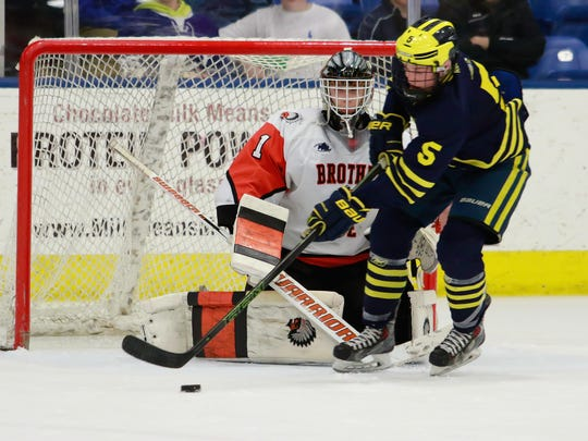 Jed Pietila (5) and his Hartland hockey teammates were