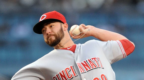 Reds starting pitcher Brandon Finnegan throws in the