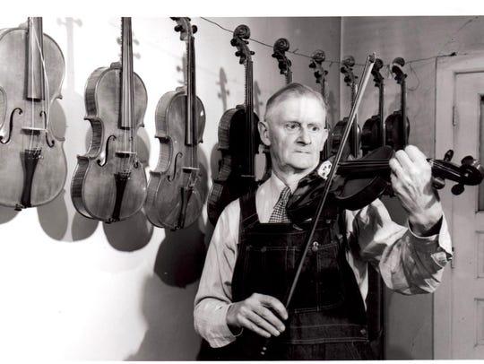 Sheboygan violin maker Alfred Ferdinand Smith tests