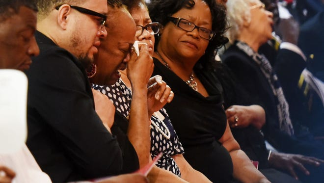 Family shed some tears during the celebration of life and legacy for social and civil rights activist E. E. Jones.