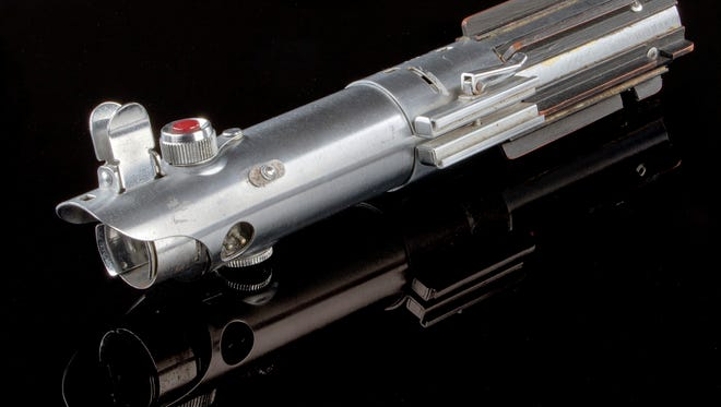 """This 2017 photo provided by Profiles in History shows a light saber used by Mark Hamill's Luke Skywalker character in the movies """"Star Wars"""" and """"Star Wars: The Empire Strikes Back"""" that will be among several Star Wars-related items up for auction on June 26-28, 2017, by the auction house in Calabasas, Calif. (Lou Bustamante/Profiles in History via AP)"""