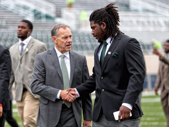 Mark Dantonio with Auston Robertson before a 2016 game against Michigan at Spartan Stadium.