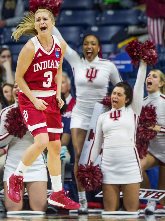 Indiana's TyraBuss (3) celebrates as her team takes the lead over Georgia in the second half of a first-round women's college basketball game in the NCAA Tournament, Saturday, March 19, 2016, in South Bend, Ind. (AP Photo/Robert Franklin)