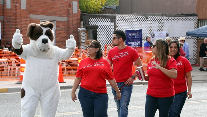 People and their furry friends were dancing in the streets during the 10th annual Coats for Kids event.