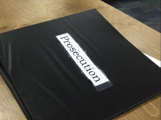 A prosecution binder in the youth court program room