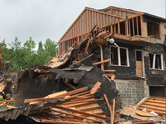 Demolition of the abandoned Lakeside Manor townhouses began Tuesday in Wanaque, N.J. after the owner walked away from the project 15 years ago.