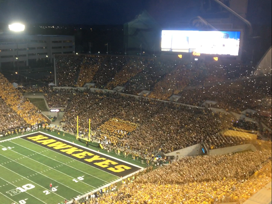 The Hawkeye Wave from Iowa's game vs. Penn State featured cell phone flashlights to create a sea of lights.