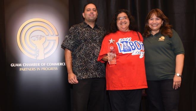 In this Aug. 31, 2017, filed photo, Jacqueline Barrett, center, Barrett Plumbing vice president, proudly displays the 2017 Small Business Excellence Award. With Barrett are Guam Chamber of Commerce President Catherine Castro, right, and Bobby Shringi, Chamber board chairman.