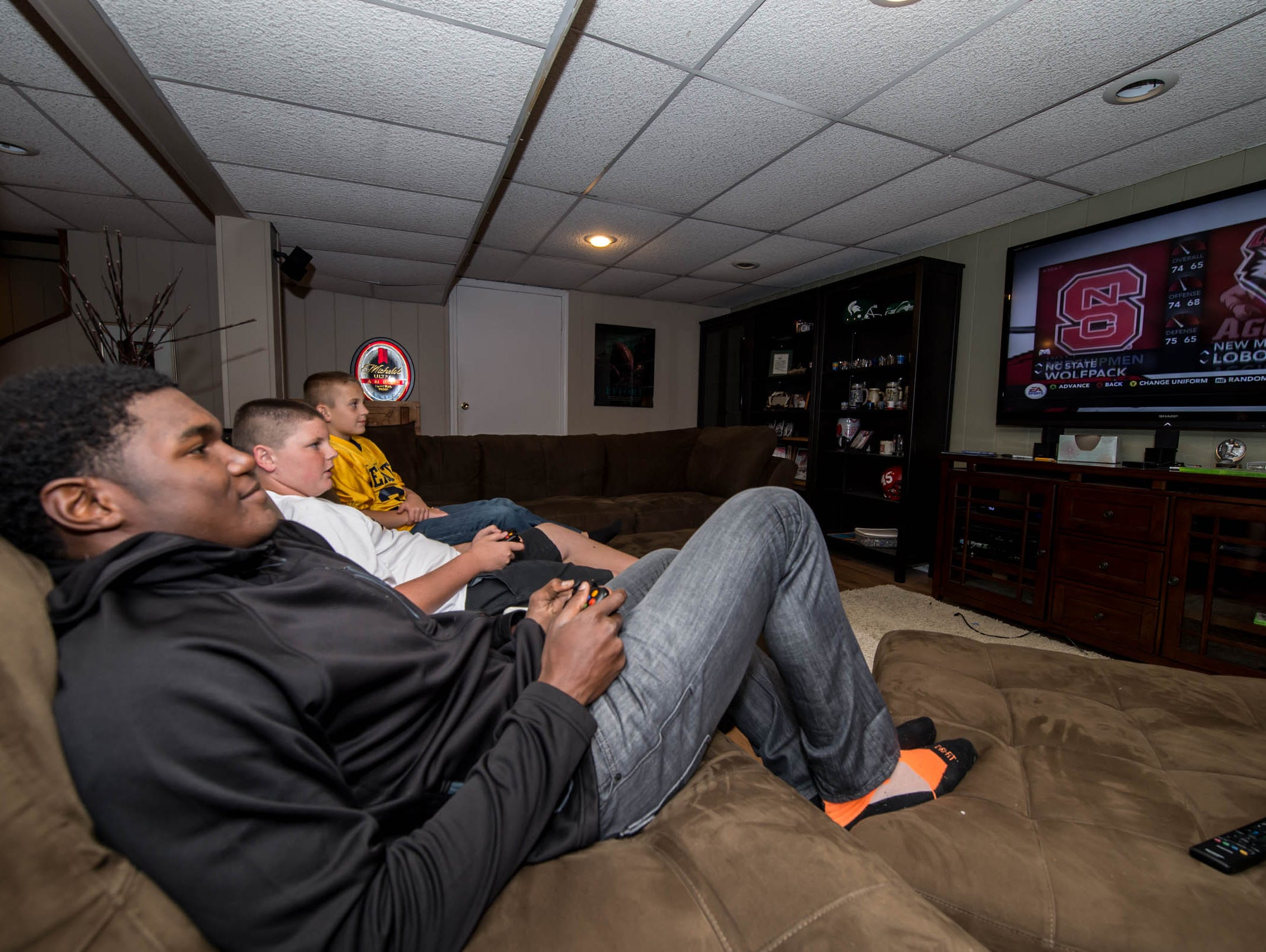BCC senior Brandon Randle playing video games with his 'little brothers' Kyler and Kayden Randle