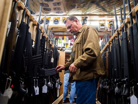 Denton Swisher, of Waynesboro, browses a selection of rifles at Redding's Hardware on Wednesday Dec. 16, 2015 in Gettysburg. Swisher, an avid sportsman, says he frequently visits Redding's Hardware in Gettysburg for their selection and expertise.