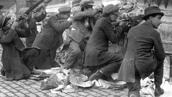 Barricades are manned by Irish insurgents during the Easter Rising. Nearly 500 people were killed and over 2,600 wounded.