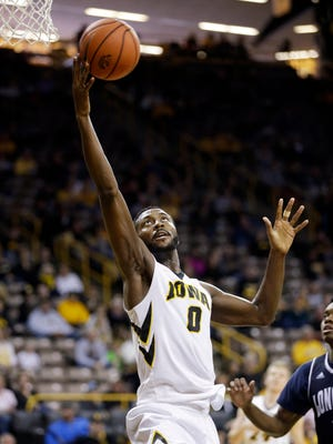 Iowa's Gabe Olaseni pulls down a rebound during the second half of the Hawkeyes' game against Longwood. Iowa won 77-44.