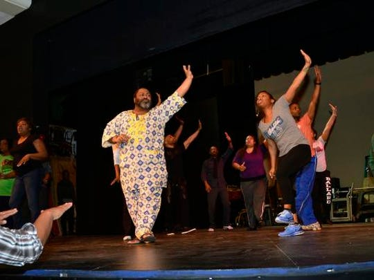 "Director Rush Trowel, left, gives encouragement during CenterStage's rehearsal of ""The Color Purple"" at the Jewish Community Center. The play will open Thursday. <137>March 20.<137>"