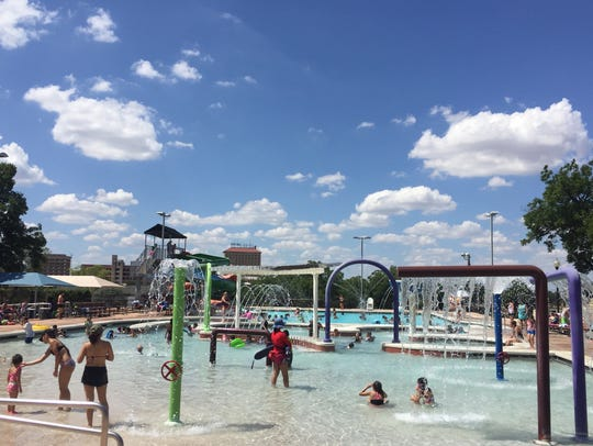 Residents play in the shallow end of San Angelo's Love
