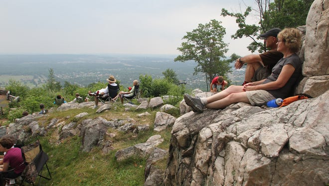 Kristal and Jerry Knapp, Wausau, sit on a rock during a 2011 concert at the Rib Mountain State Park Ampitheater. The concert was put on by the Friends of Rib Mountain.