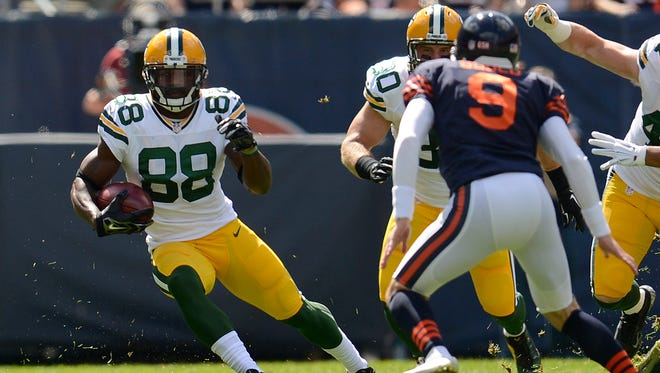 Green Bay Packers' Ty Montgomery (88) runs with the ball during a kick-off return against the Chicago Bears during Sunday's game at Soldier Field in Chicago.
