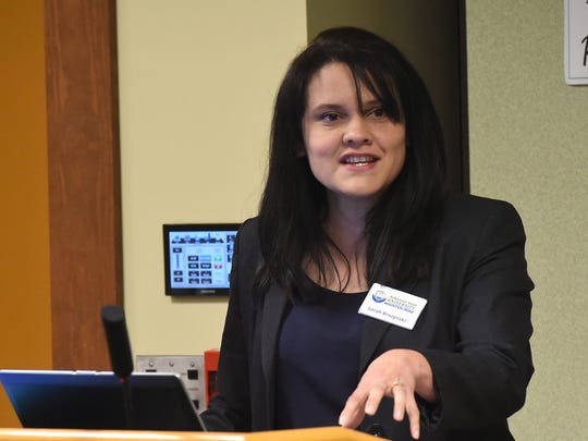 Sarah Brozynski, ASUMH Home Workforce Development director, speaks to members of the Arkansas Economic Development Commission on Thursday about the school's workforce program.