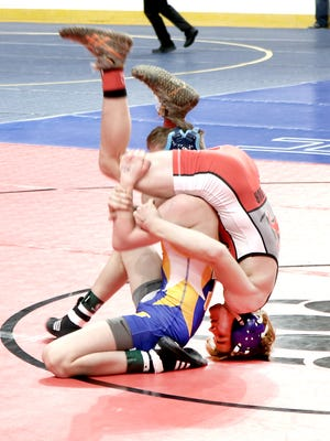 Norwich's Dante Geislinger, right, wrestles Central Valley Academy's Mason Bush in a 99-pound semifinal Saturday in the NYSPHSAA Championships at the Times Union Center in Albany. Geislinger advanced with a 6-2 victory.