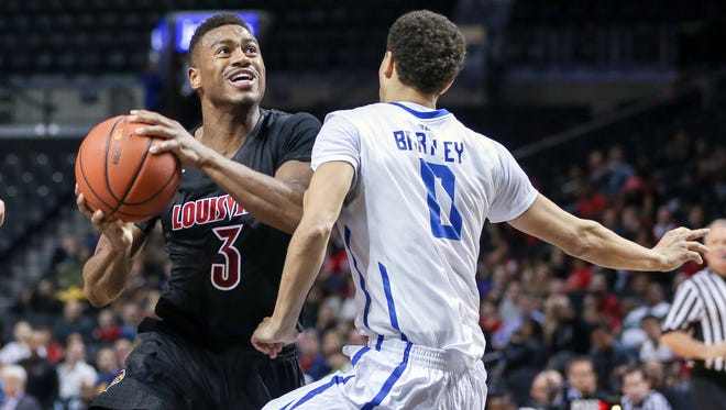 Nov 28, 2015; Brooklyn , NY, USA; Louisville Cardinals guard Trey Lewis (3) looks to shoot while defended by Saint Louis Billikens guard Marcus Bartley (0) at Barclays Center. Mandatory Credit: Vincent Carchietta-USA TODAY Sports