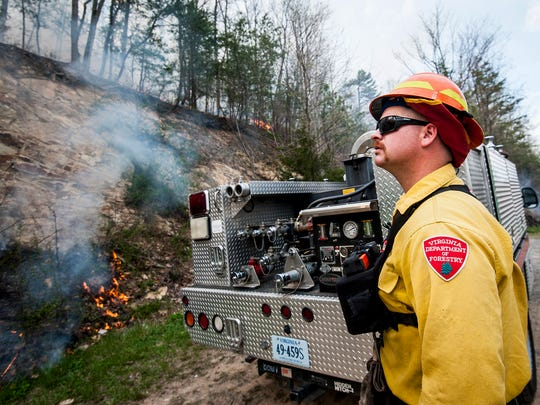 Wildland fire engine operator Jeremy Lauck watches