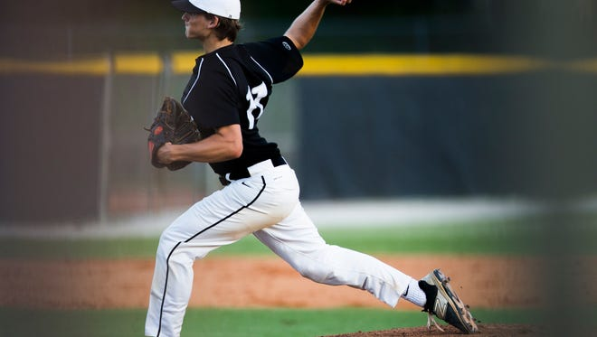 Niels Stone pitches the ball during the class 7A regional final game against Land O'Lakes-Sunlake at Gulf Coast High School on Tuesday, May 23, 2017.