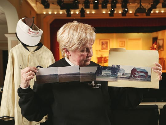 Iowa casting coordinator Sue Riedel shows the photos of Don Lansing's Dyersville farm that she sent to the production company looking for an iconic farm to use for the film Field of Dreams.