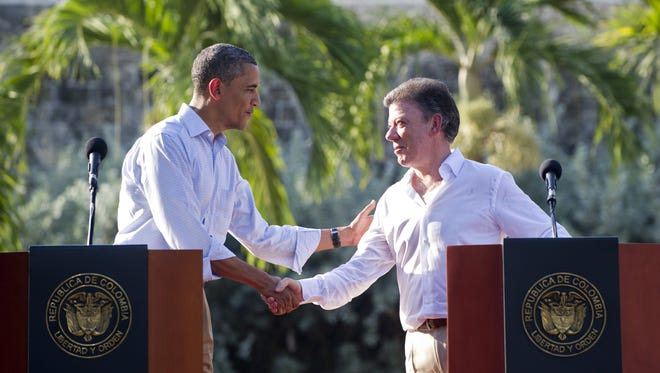Colombia President Juan Manuel Santos and President Barack Obama shake hands during a joint press conference on April 15, 2012.