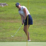 Notre Dame's Erin Durstock chips onto the green for her final hole at the Cooper Invitational.