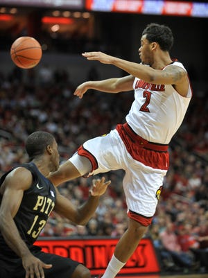 Louisville's Quentin Snider gets a pass off in the lane in the second half.  Feb. 11, 2015.
