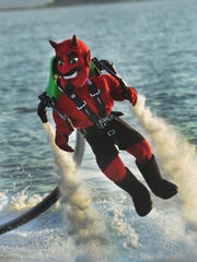 The Dewey Devil flies above the water at northbeach