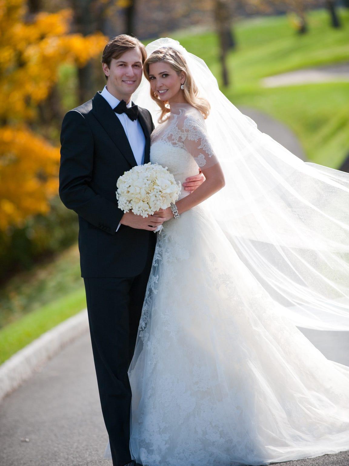Ivanka Trump and Kushner pose at their wedding at Trump