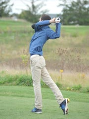 Jack McElligott tees off on the 11th hole at Red Hawk
