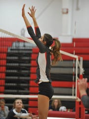 Lexi Evak jumps up for a block against Carey.