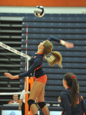 Galion's Sam Comer smashes one at the net.