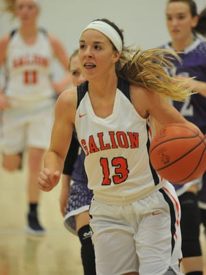 Gabby Kaple drives toward the hoop against Mt. Gilead.