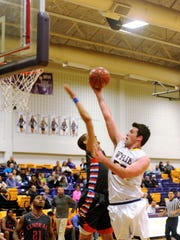 Wylie forward Kyle Roberts goes to the basket against