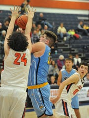 River Valley's AJ Kenney drives to the basket with Galion's Tristan Williams defending him.