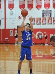 Wynford's Josh Crall shoots a free throw.