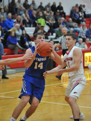 Wynford's Cole Heinlen drives to the basket.