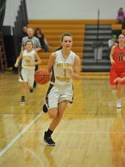 Colonel Crawford's Hailey Miller drives down the court.