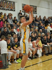 Colonel Crawford's Gavin Feichtner shoots a 3-pointer.