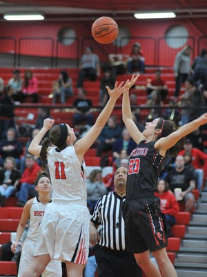 Bucyrus' Shaina Orewiler and Buckeye Central's Emily Stump battle for the tip-off.