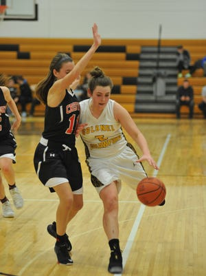 Colonel Crawford's Danielle Horsley drives down the court with Crestview's Kathleen Leeper guarding her.