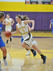 Colonel Crawford's Hailey Miller drives to the basket.