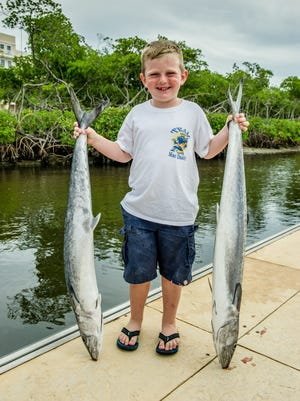 """""""It was hard to reel it in -  and I love fishing,"""" said 5-year-old Carson McDade of Tavares."""