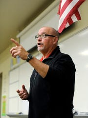 Joe Chavalia, a trainer from the ALICE Training Institute, leads Friday's class for teachers and other attendees on how to handle active shooter scenarios at Chillicothe High School.