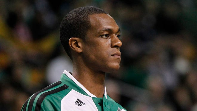 Jan 15, 2014; Boston, MA, USA;  Boston Celtics point guard Rajon Rondo (9) on the sideline during the fourth quarter against the Toronto Raptors at TD Garden.  The Boston Celtics won 88-83. Mandatory Credit: Greg M. Cooper-USA TODAY Sports